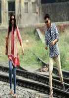 Piku Deepika Padukone In Blue Jeans and Red Topper With Irfan Khan Stills