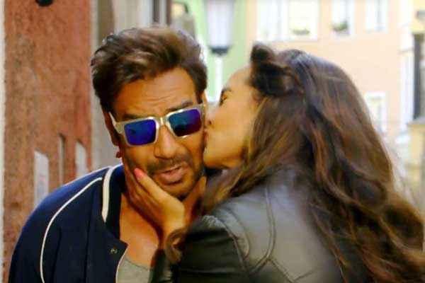 Action Jackson Sonakshi Sinha Kissing Ajay Devgn Stills