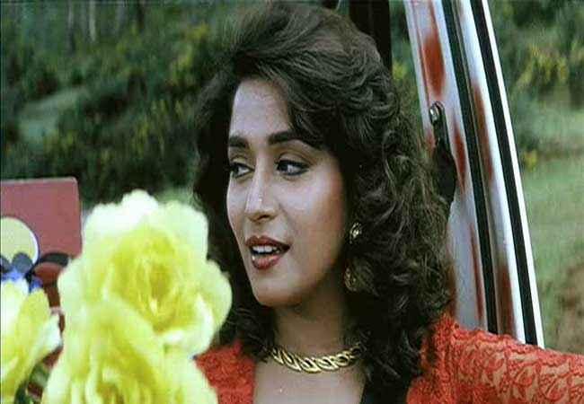 Hum Aapke Hain Kaun Madhuri Dixit with Yellow Flower Stills