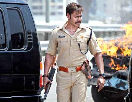 Singham Returns Ajay Devgn With Gun Pics Stills