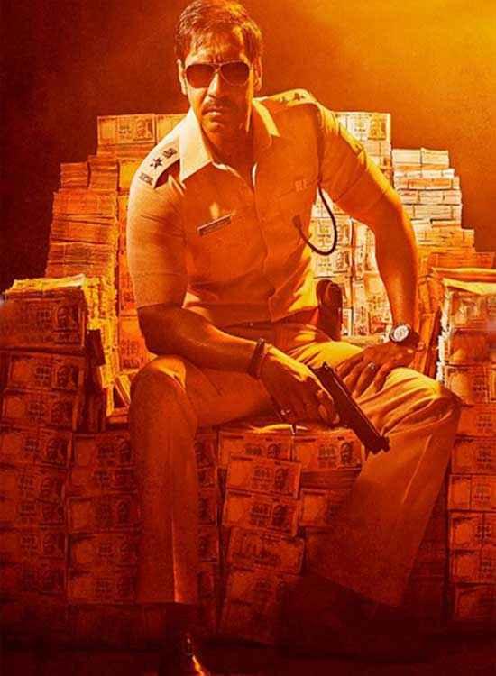 Singham Returns Ajay Devgn With Gun Stills